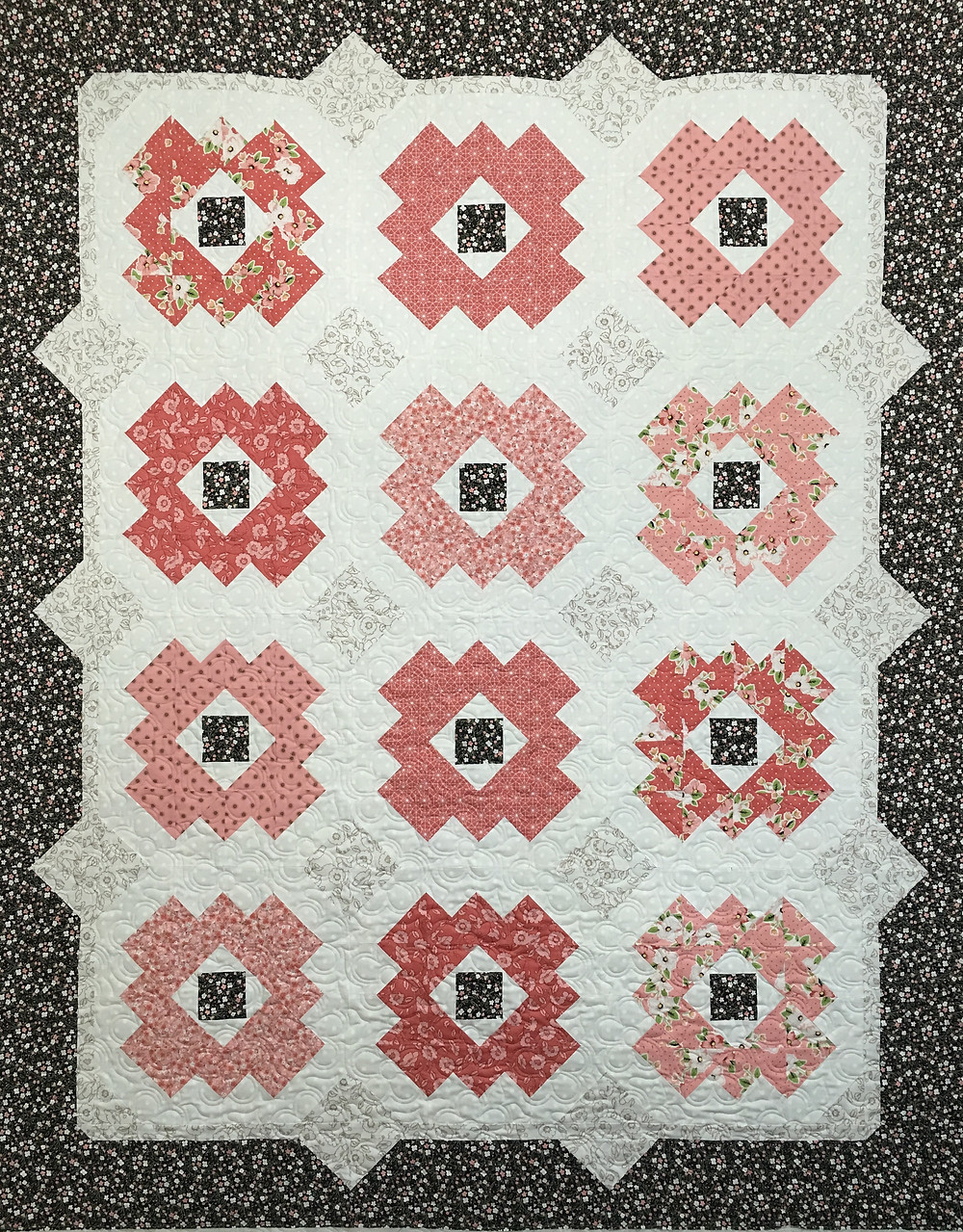 Sarah Daisy Path Quilt in shades of Pink