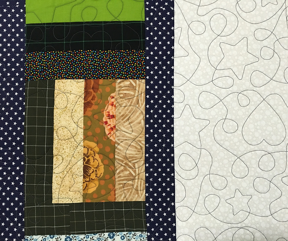 Stars and Hearts quilting design on Jelly Bean Dreaming Memories quilt by Judi Castro