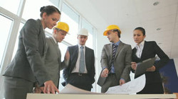 stock-footage-three-businessmen-or-engineers-in-hardhats-discussing-a-new-project