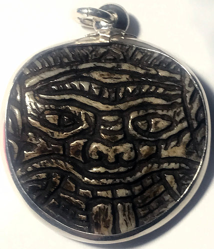 An Old Burmese Carved Panneng of a Demon in silver