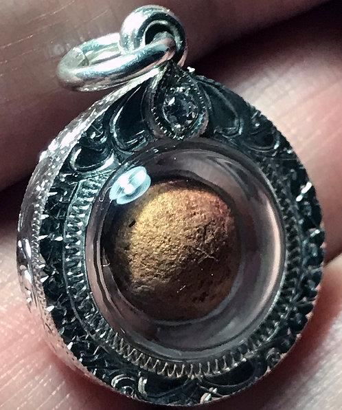 The Exceptional Yaa Daeng Maha Pee Ya Amulet by Phra Ajarn O in silver
