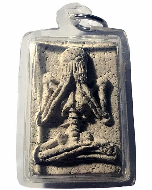 A Ghost Phra Pidtaa Prai Amulet with the bone of Kruba Inn Taa