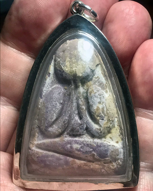 A Bone Powder Phra Pidtaa Amulet by Luang Phor Pina in silver