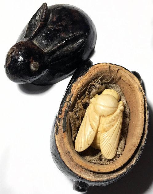 A Beautiful Old Bone Tai Yai Wicha Bee Amulet with mercury in a rabbit box
