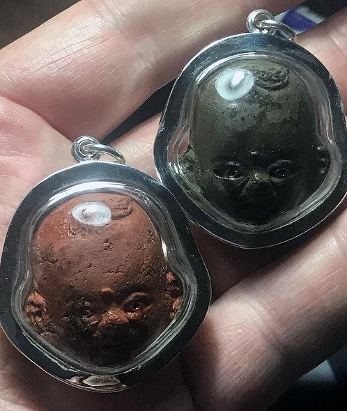 The Twin Luk Krok Amulets of Phor Noi Tan in silver