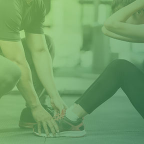 Trainer helping women workout