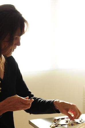 Janet Christenot artist working in studio
