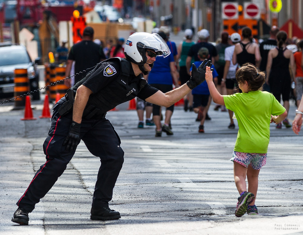 Ottawa Police Sergeant High-Fives participants.