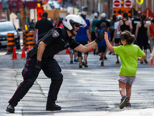 Ottawa Police Officer High-Five's  Participants.