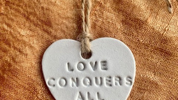 Love Conquers all keepsake charm