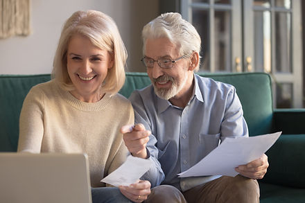 Happy old retired couple paying domestic