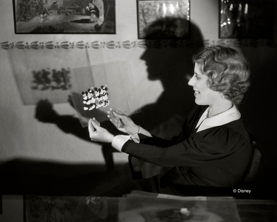 Ink & Paint Department Head Hazel Sewell holds a cel from The Pet Store (1933)