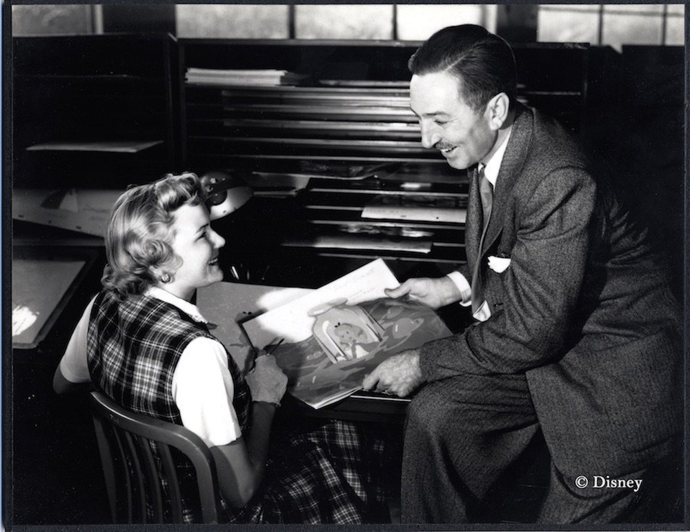 Inker Ginni Mack and Walt Disney review production art for Alice in Wonderland, (ca. 1950).