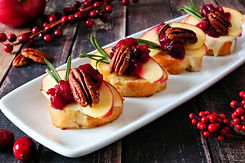 Crostini appetizers with apples, cranber