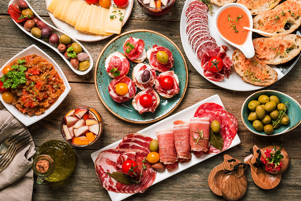 spanish tapas and sangria on wooden tabl