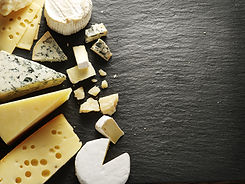 Different types of cheeses on black boar
