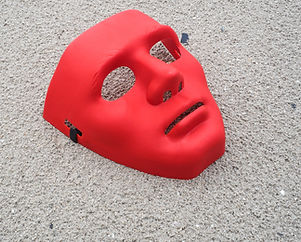Red Mask on Sand Background.jpg