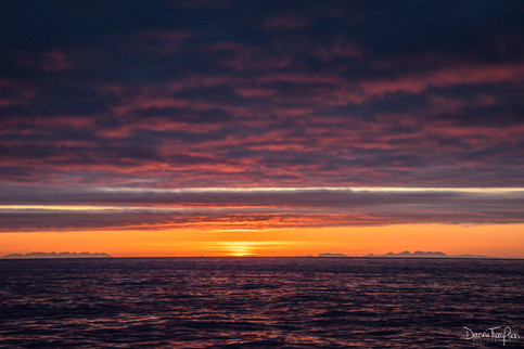 Sunrise between Skye to the left and Eigg, Rum and Canna to the right