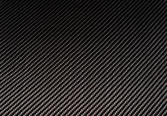 Woven carbon fiber sheet. Texture. Macro