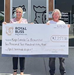 KLCB President accepts donation check