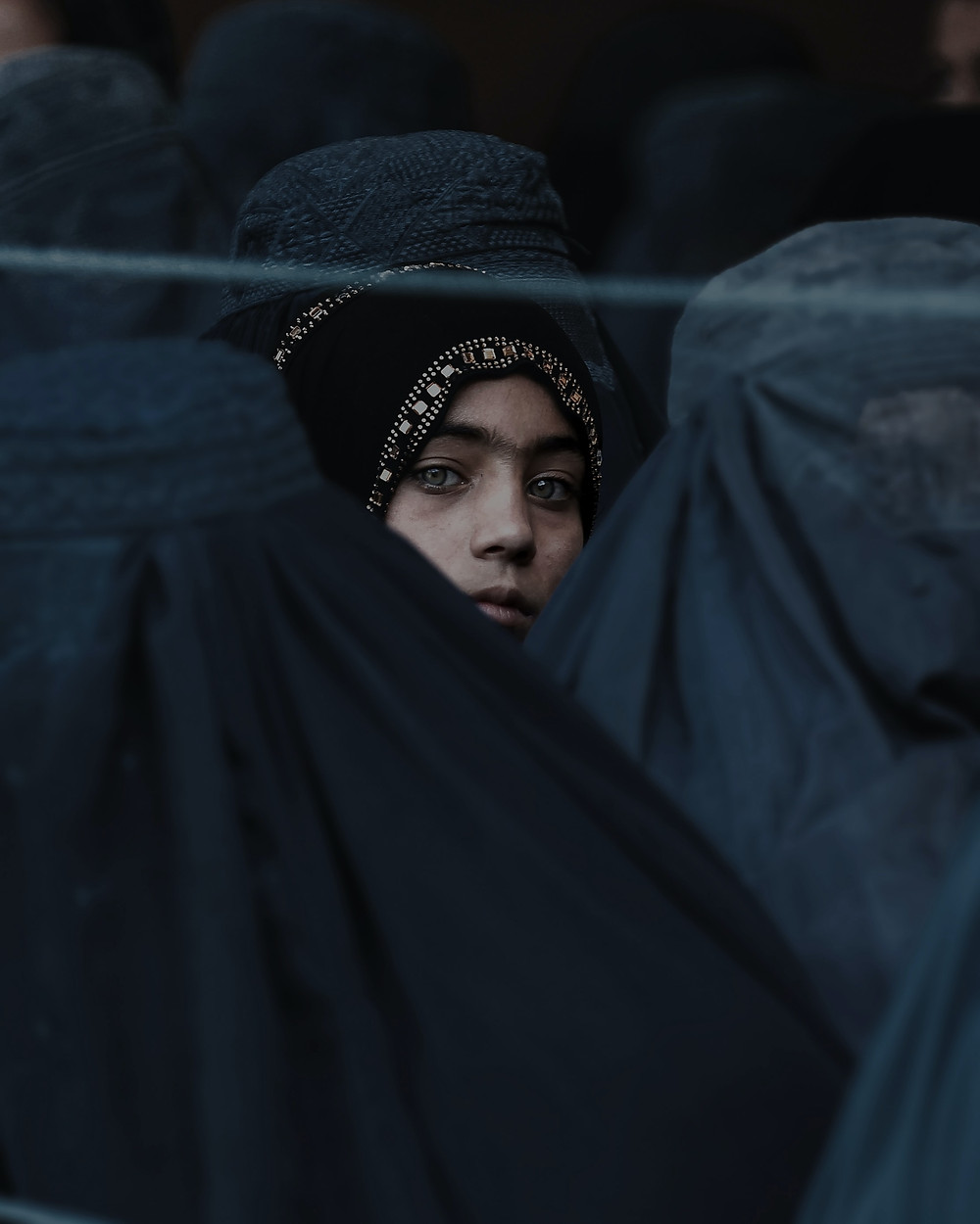 A Girl Looks on Among Afghan Women Lining Up To Receive Relief Assistance, During The Holy Month of Ramadan in #Jalalabad, #Afghanistan. Photo Credit  IsaaK Alexandre KaRslian on Unsplash