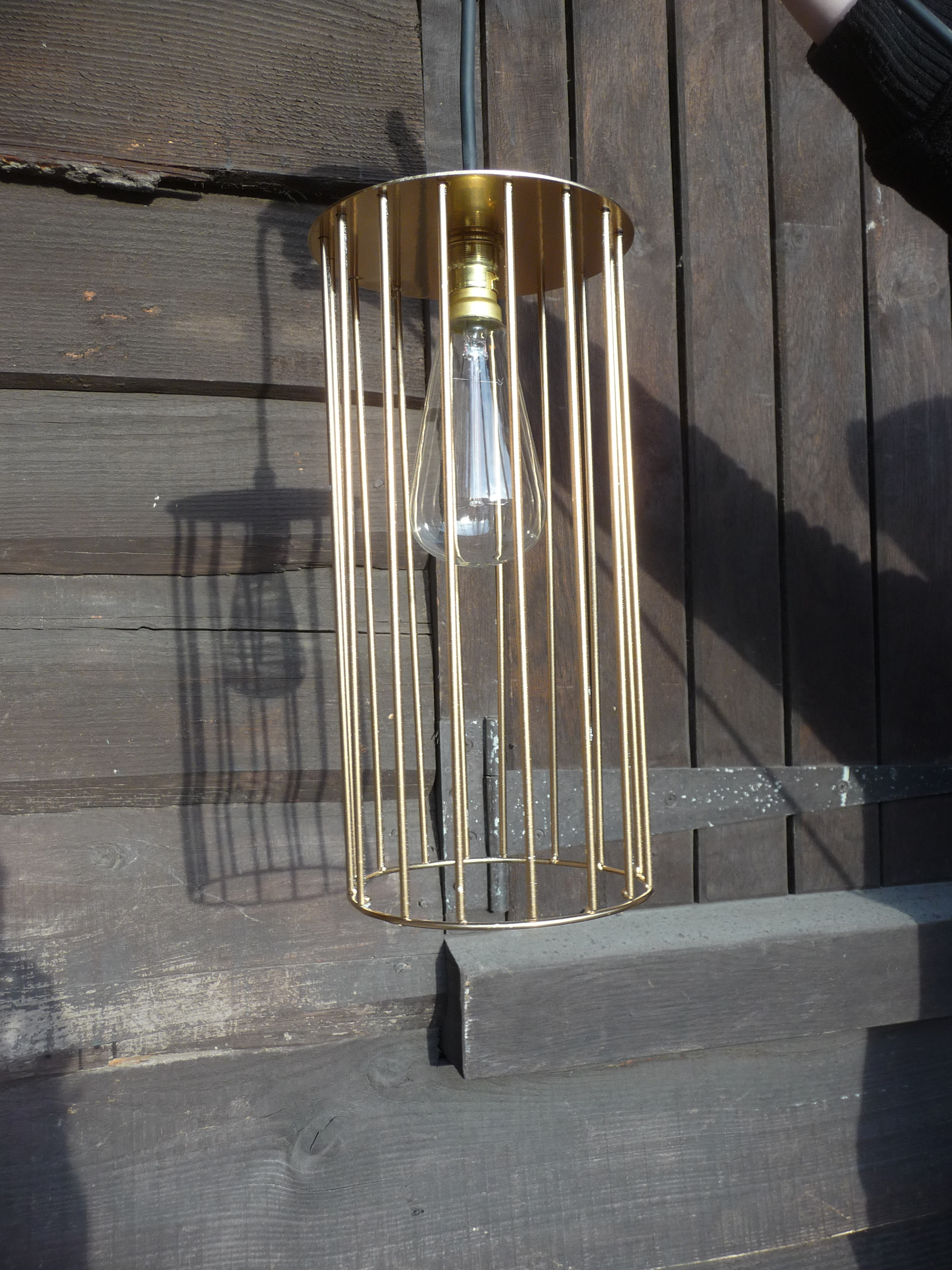 gold cylinder caged pendant