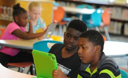 iPlanets Academy kids on ipads
