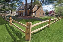 wood post and rail fence.jpg