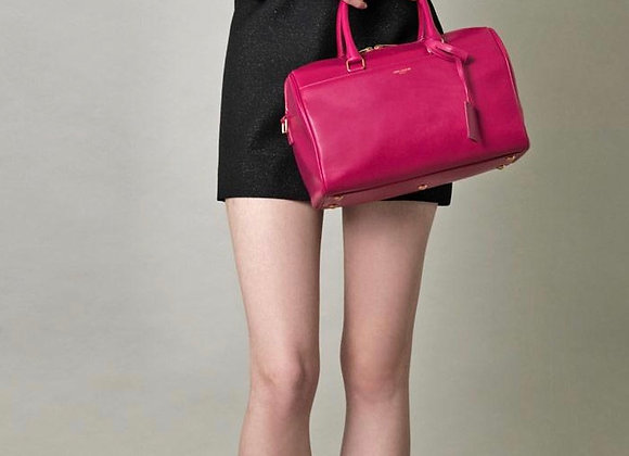 Ysl classic duffle fucsia preowner with cross bel
