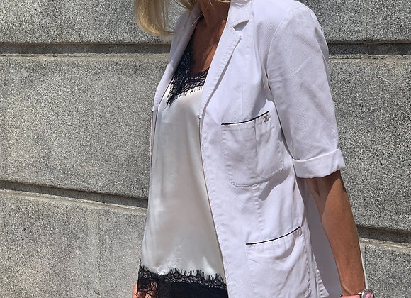 Chanel white jacket preowner size m ,with cc on the pocket