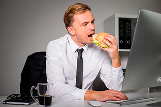website man eating at desk.jpg