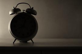 bedside alarm clock in backlit.jpg