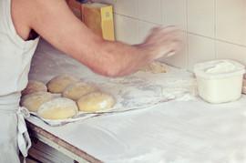 Baker preparing bread dough copia.jpg