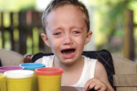 Boy crying in a summer school.jpg