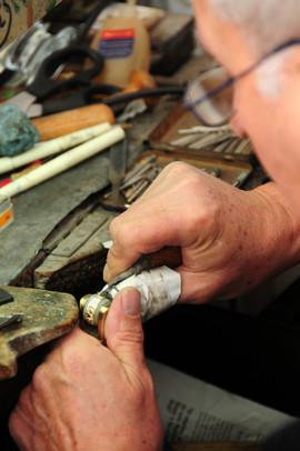Craftsman engraving a ring.jpg