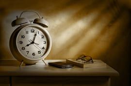 bedside alarm clock and personal belongi