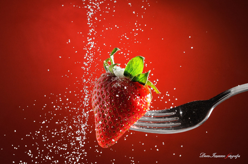 Strawberry on a fork punctured falling sugar detail.jpg
