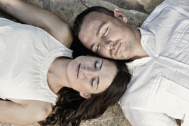 Young couple lying on a stone floor with