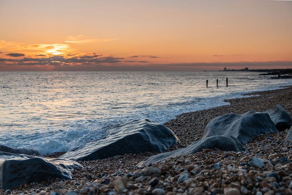Sunset on a pebble beach on the South Coast of England