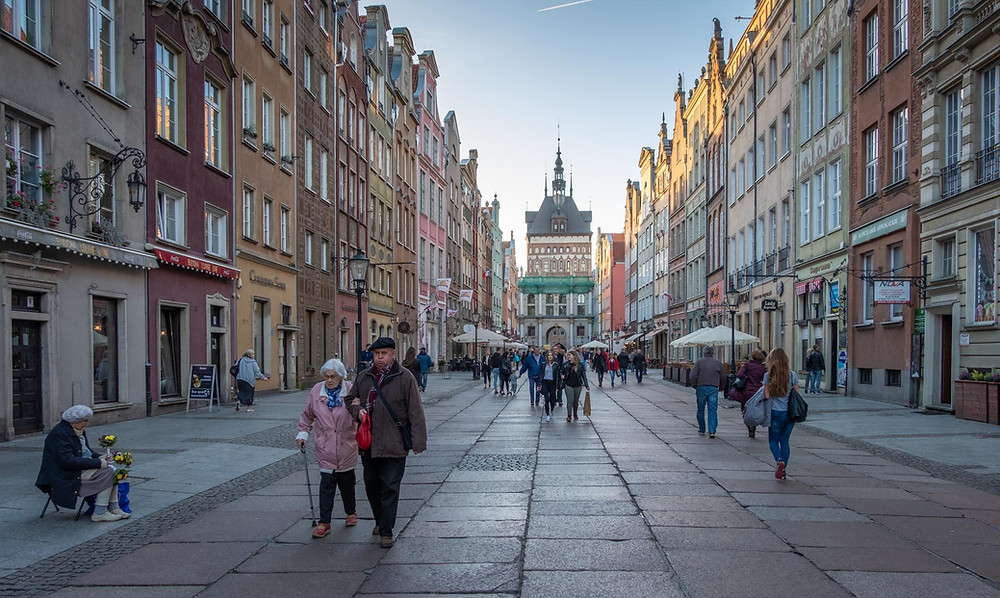 An old couple walk down the beautiful streets of Gdansk, Poland with it's stunning architecture