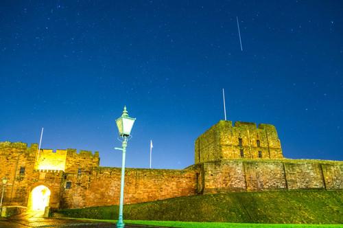 A meteor passes Carlisle Castle