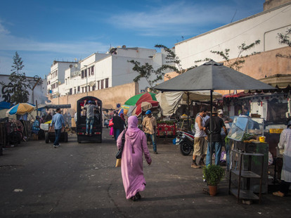 A woman walks down one of the many markets in Casablanca