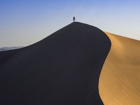 Standing atop one of the sand dunes in Huacachina