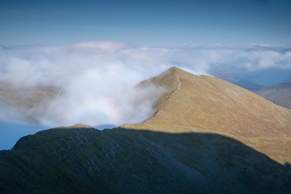 A Brocken Spectre on Swirral Edge as seen from the summit of Helvellyn on a cloudy day
