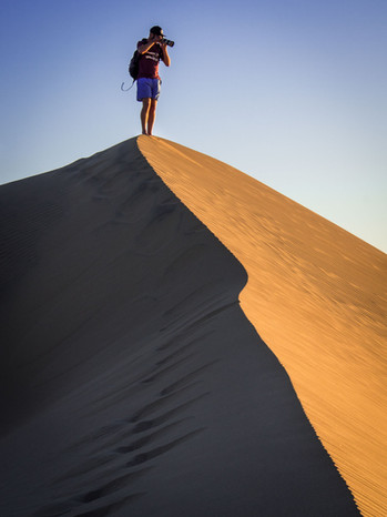 Taking Photos from the top of one of the sand dunes in the desert of Huacachina