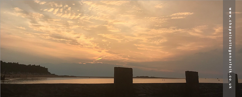 Wells-next-the-Sea Pinewoods Beachhuts dusk Norfolk coast hightide