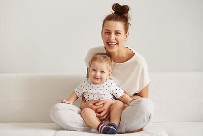 Utah doula holding baby in lap