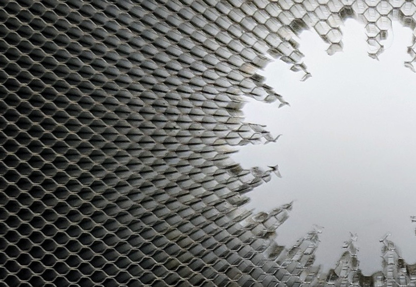 honeycomb substrate with an electrochemically machined sunburst-shaped cut out, with no deformation