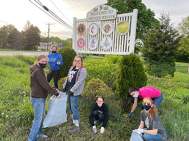 Girl Scouts fixing up Welcome Sign.jpg