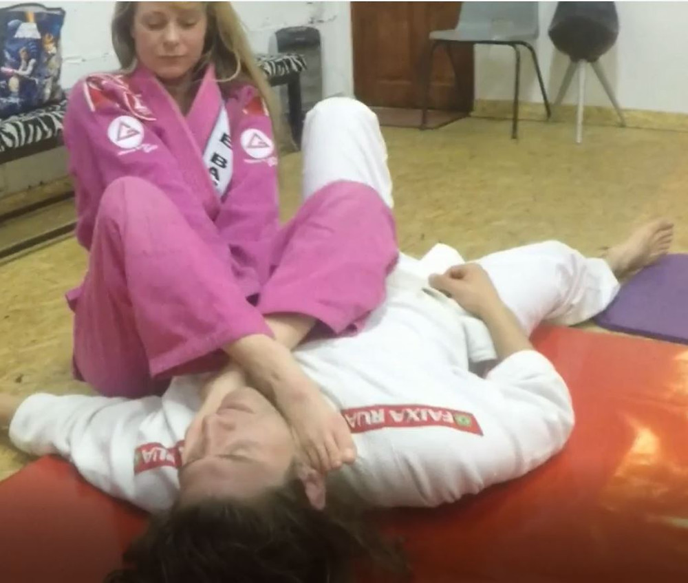 Lisa King chokes Bert with her feet